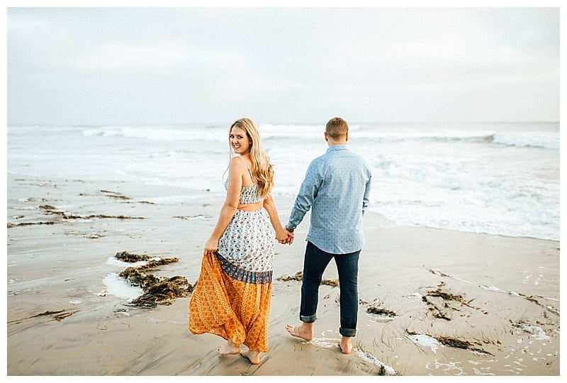 open back orange dress engagement photos at the beach